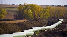 The Keystone XL pipeline under construction in North Dakota. Transcanada Corp has announced Heartland, a new pipeline that will run 200 kilometres between the Edmonton region and Hardisty, Alta., the start point of the Keystone system. It could ultimately transport 900,000 barrels of crude per day. (Reuters)