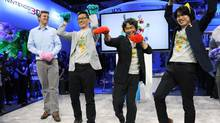 In this photo provided by Nintendo of America, famed video game designer Shigeru Miyamoto (red paws) and fellow developers Yoshiaki Koizumi (yellow paws) and Koichi Hayashida (blue-green paws), playfully demonstrate the cat transformation in Super Mario 3D World during the Wii U Software Showcase E3 2013 on June 11, 2013 in Los Angeles. (Bob Riha Jr./Associated Press)