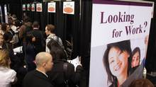 Job seekers line up at a job fair and in Toronto. (Fernando Morales/Fernando Morales/The Globe and Mail)