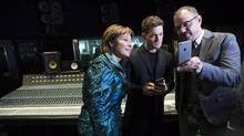 Matthew Good, right, speaks with Michael Bublé and B.C. Premier Christy Clark after Thursday's announcement in Vancouver that the province will give 15 million to promote B.C. music during a news conference in Vancouver on Thursday. (JONATHAN HAYWARD/THE CANADIAN PRESS)