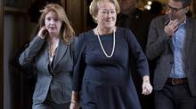 Quebec Premier Pauline Marois, centre, walks to question period Thursday, November 7, 2013 at the legislature in Quebec City. (Jacques Boissinot/THE CANADIAN PRESS)