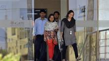 Employees walk out of a building at the Indian headquarters of iGate in the southern Indian city of Bangalore February 4, 2013. (Reuters/REUTERS)
