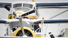 A member of Harbour Air's ground crew cleans the window of a floatplane in Vancouver's Coal Harbour June 3, 2010. (John Lehmann/Globe and Mail/John Lehmann/Globe and Mail)