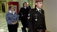Cpl. Matthew Wilcox of Glace Bay, N.S., is followed by family members at his court martial in Sydney, N.S. on June 23, 2009. The reservist faces charges in the shooting death of another Canadian soldier in Afghanistan. (ANDREW VAUGHAN)