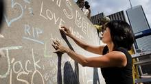 Olivia Chow, wife of the late Jack Layton, writes a message of love with chalk on a wall outside Toronto City Hall on the anniversary of Layton's death Aug 22, 2012. (Moe Doiron/The Globe and Mail) (Moe Doiron)