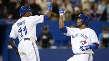 Toronto Blue Jays Edwin Encarnacion celebrates his home run with team mate Rajai Davis against the Boston Red Sox during the fight inning of their American League baseball game in Toronto April 30, 2013. (MARK BLINCH/REUTERS)
