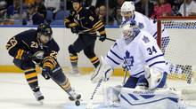 Buffalo Sabres' Ville Leino (23) shoots the puck in close at Toronto Maple Leafs' James Reimer (34) as Leafs' Mark Fraser and Sabres' Steve Ott watch during the first period of an NHL hockey preseason game in Buffalo, N.Y., Saturday, Sept. 21, 2013. (GARY WIEPERT/AP)