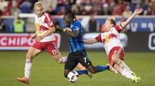 Montreal Impact forward Dominic Oduro is tackled by New York Red Bulls midfielder Dax McCarty during a game on Nov. 6, 2016.s (Vincent Carchietta/USA Today Sports)