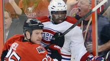 Ottawa Senators' Chris Neil pushes Montreal Canadiens' P.K. Suban into the boards during game three of first round NHL Stanley Cup playoff hockey at the Scotiabank Place in Ottawa on Sunday, May 5, 2013. (The Canadian Press)
