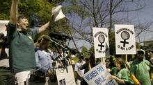 Martha Burk, chair of the National Council of Women's Organizations, speaks to a group protesting the male-only membership policy of Augusta National Golf Club on April 12, 2003. (MIKE SEGAR/REUTERS)