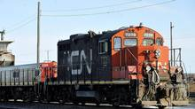 A CN locomotive goes through the CN Taschereau yard in Montreal on Nov., 28, 2009. (GRAHAM HUGHES/THE CANADIAN PRESS)
