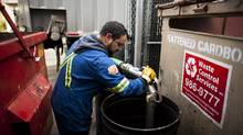 Vince Voth of West Coast Reduction Ltd. collects used cooking grease from the Boathouse restaurant in Vancouver, British Columbia, Monday, November 14, 2011. (For The Globe and Mail/Rafal Gerszak)