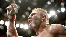 : Brock Lesnar celebrates after defeating Frank Mir in their heavyweight title bout at UFC 100 at Mandalay Bay in Las Vegas Saturday, July 11, 2009.(AP Photo/Las Vegas Review-Journal, John Locher)