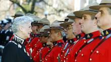 B.C. Lieutenant-Governor Iona Campagnolo inspects members of the Royal Canadian Mounted Police prior to the speech from the throne in Victoria, Feb. 8, 2005. (Deddeda Stemler/The Canadian Press/Deddeda Stemler/The Canadian Press)