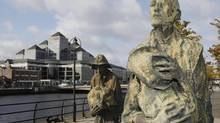 Statues depicting the Irish Famine of the nineteenth century dominate a quayside in the financial district of Dublin in this file photo. (Niall Carson/AP)