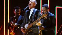 "Sting paid tribute to Bob Marley by singing an old Police hit, ""Walking on the Moon."" (Reuters)"
