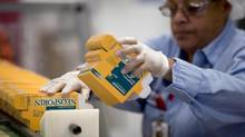 A Johnson & Johnson employee at work. (Andrew Harrer/Bloomberg)