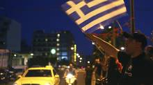 Supporters of the extreme-right Golden Dawn party celebrate early election results outside their headquarters in Athens on May 6, 2012. (YANNIS BEHRAKIS/Yannis Behrakis/Reuters)