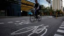 A cyclist uses the Hornby St. bike lane in downtown Vancouver, B.C., on Friday October 7, 2011. (DARRYL DYCK FOR THE GLOBE AND MAIL)