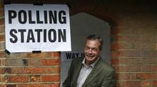 Nigel Farage, leader of Britain's United Kingdom Independence Party (UKIP) poses of the media after voting for the European Parliament in Cudham , England, Thursday May 22, 2014. (LEFTERIS PITARAKIS/AP)