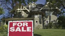 For Sale sign in front yard of house (Brand X Pictures/Getty Images/Brand X)