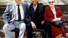 A young Barack Obama, exuding confidence, poses with his maternal grandparents, Stanley and Madelyn Dunham. (HO/Reuters)