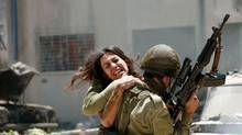 A woman struggles with an Israeli soldier in a scene from Lebanon.