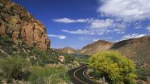 Desert landscape with a road (Comstock Images/Getty Images/Comstock Images)