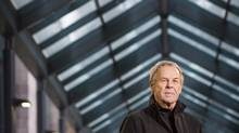 Retired CBC journalist Linden MacIntyre stands outside the offices of his book publisher Random House in downtown Toronto on Nov. 17, 2014. (John Hryniuk for The Globe and Mail)