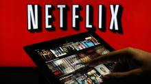 A man scrolls through a selection of viewing choices on the Netflix Inc. application on a tablet device in this arranged photograph in London, U.K., on Tuesday, Jan. 5, 2016. Despite the rumours, Netflix and it's fully formed business model has little to offer reported suitors Disney or Apple. (Chris Ratcliffe/Bloomberg)