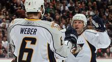 Mike Fisher #12 of the Nashville Predators celebrates a goal by Shea Weber #6 against the Anaheim Ducks. (Photo by Jeff Gross/Getty Images) (Jeff Gross/Getty Images)