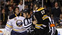 Buffalo Sabres goalie Ryan Miller (30) has some words with Boston Bruins left wing Milan Lucic (17) after being charged during the first period at TD Banknorth Garden. (Greg M. Cooper-US PRESSWIRE/Greg M. Cooper)