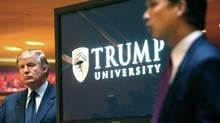 In this May 23, 2005, file photo, now Republican presidential candidate Donald Trump listens at left as Michael Sexton introduces him at a news conference in New York where he announced the establishment of Trump University. Among the people with serious financial problems who taught for Trump University is a case that crossed international borders: an Ontario couple who securities regulators sanctioned over a multimillion-dollar fraud. (Bebeto Matthews/AP)