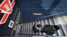 Commuters exit the TTC's St. Andrew subway station on Feb. 24, 2014. (Fred Lum/The Globe and Mail)