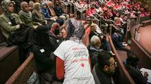 During a Peel District School Board meeting on April 12, a supporter of religious accomodations wears a t-shirt with the saying 'Respect existance or expect resistance.' (Glenn Lowson/The Globe and Mail)