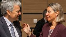 Belgium's foreign minister Didier Reynders, left, speaks with EU Council High representative Federica Mogherini during a meeting of EU foreign ministers at the EU Council building in Luxembourg, Monday, Oct. 17, 2016.