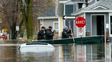 People row a boat in a flooded residential area in Gatineau, Quebec, Canada, May 7, 2017 (Chris Wattie/REUTERS)