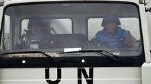 A UN peacekeeper from the Philippines drives leaves the Ziouani camp to cross into Syria at the Quneitra crossing between Syria and the Israeli-controlled Golan Heights on Friday, March 8. The Philippine government said Syrian rebels failed to release 21 Filipino UN peacekeepers on Friday and stuck to their demands for repositioning of Syrian government forces before any handover. (Ariel Schalit/Associated Press)