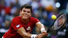 Canada's Milos Raonic returns the ball to Serbia's Novak Djokovic during their Davis Cup semi-final match in Belgrade September 15, 2013. (MARKO DJURICA/REUTERS)