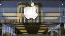The Apple logo is pictured on the front of a retail store in the Marina neighborhood in San Francisco, California April 23, 2014. (© Robert Galbraith / Reuters)