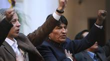 Bolivia's President Evo Morales, right, sings the national anthem in La Paz, May 1, 2012. Mr. Morales announced on May Day that Bolivia is nationalizing the local unit of Spain's Red Electrica. (Juan Karita/JUAN KARITA/AP)