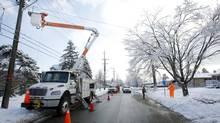 Enwin Utilities workers repair damaged power lines in Scarborough on Dec. 26, 2013. (KEVIN VAN PAASSEN/THE GLOBE AND MAIL)