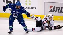 Chicago Blackhawks' Patrick Kane gets tangled with Vancouver Canucks' Kevin Bieksa's stick. (Darryl Dyck/The Canadian Press/Darryl Dyck/The Canadian Press)