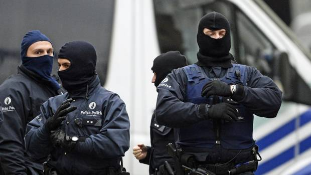 Heavily armed special forces stand guard outside a house being searched in the Rue Delaunoy in Brussels on November 16, 2015. (DIRK WAEM/AFP/Getty Images)