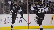 Los Angeles Kings center Jeff Carter (77) and Los Angeles Kings defenseman Willie Mitchell (33) react after Carter's third period goal against the New Jersey Devils during Game 3 of the Stanley Cup Finals, Monday, June 4, 2012, in Los Angeles. The Kings won 4-0. (Mark J. Terrill/AP)