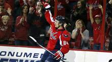 Washington Capitals centre Mikhail Grabovski celebrates a goal in the first period of an NHL hockey game, Sunday, Nov. 17, 2013, in Washington. (Associated Press)