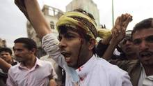 A protester shouts slogans after sustaining injuries from a confrontation with riot police who fired tear gas at them outside the U.S. embassy in Sanaa September 13, 2012. Demonstrators attacked the U.S. embassies in Yemen and Egypt on Thursday in protest at a film they consider blasphemous to Islam, and American warships headed to Libya after the U.S. ambassador there died in related violence earlier this week. (Mohamed al-Sayaghi/Reuters)