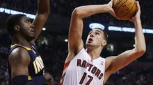 Toronto Raptors Jonas Valanciunas puts up a shot over Indiana Pacers Roy Hibbert (L) during the first half of their NBA game in Toronto October 31, 2012. (MARK BLINCH/REUTERS)