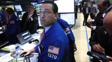 Traders work on the floor of the New York Stock Exchange August 2, 2012. (BRENDAN MCDERMID/REUTERS)