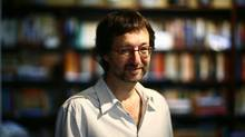 """Canadian fantasy fiction author Guy Gavriel Kay in his Toronto home in 2010: His new book is """"River of Stars."""" (Fernando Morales/The Globe and Mail)"""